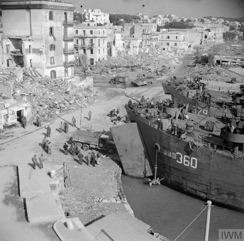 Landing ships unloading supplies in Anzio harbour, 19-24 February 1944.