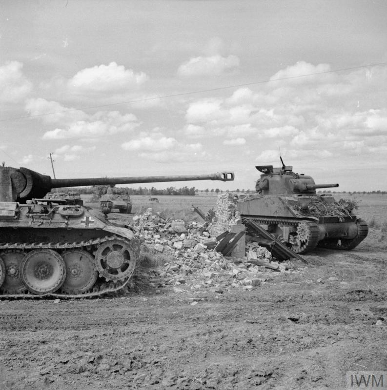 A Sherman tank of 24th Lancers, 8th Armoured Brigade, passing a knocked-out German PzKpfw V Panther tank near Rauray, 30 June 1944.