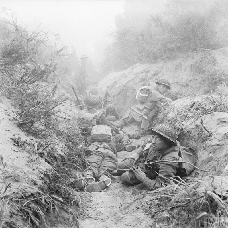 Men of 7th Cheshire Regiment, 5th Infantry Division's machine gun battalion, in a captured German communications trench during the offensive at Anzio, 22 May 1944.