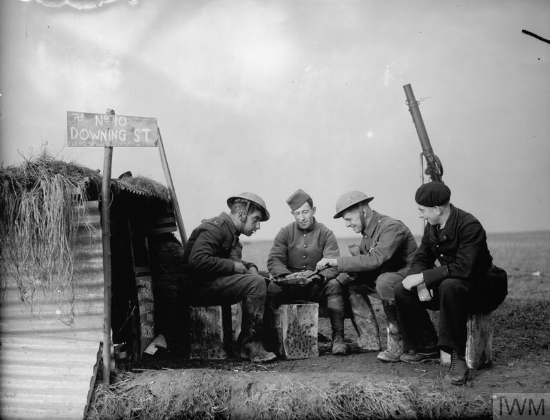 Army and French Air Force personnel outside a dugout named '10 Downing Street' on the edge of an airfield, 28 November 1939.