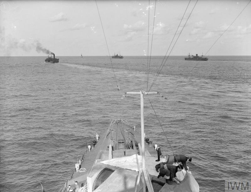 8TH ARMY VICTORY HELPS MALTA: CONVOYS, PROTECTED FROM LIBYAN AIR BASES, BRING ENOUGH SUPPLIES FOR MONTHS. 4 DECEMBER 1942, IN THE CENTRAL MEDITERRANEAN, ABOARD HMS EURYALUS.