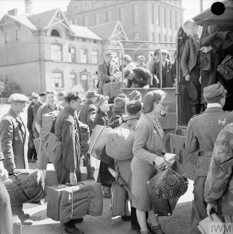 © IWM BU 6629 People awaiting admission to No.17 Displaced Persons Assembly Centre at Hamburg Zoological Gardens.