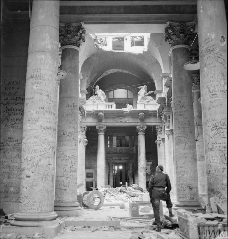 Graffiti left by Russian soldiers covers the pillars inside the ruins of the German Reichstag building in Berlin.