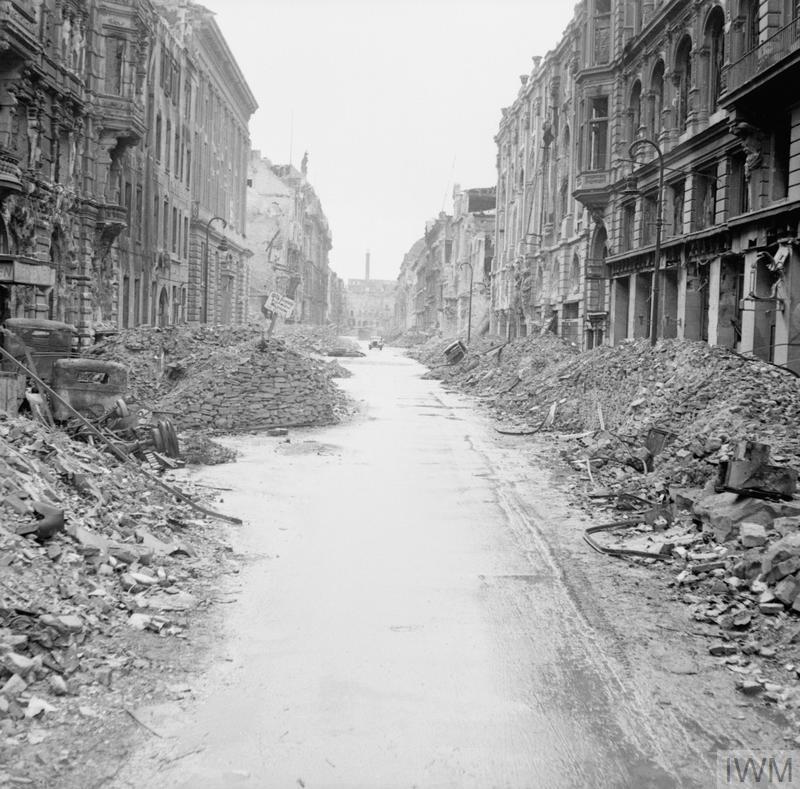 (© IWM BU 8604) Scene of destruction in a Berlin street just off the Unter den Linden.