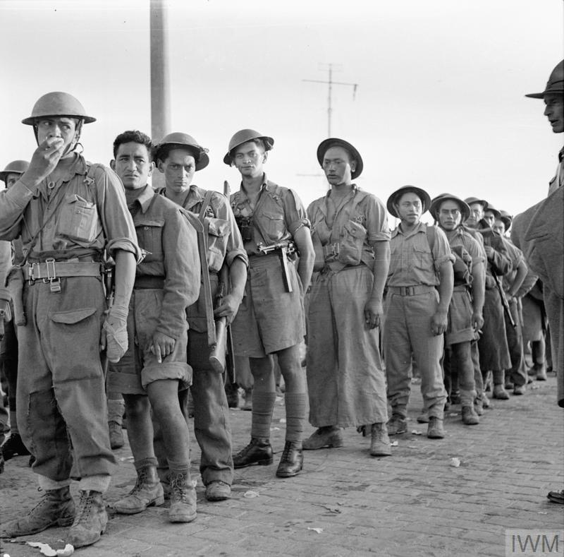 Maori troops line up on the quayside at Alexandria in Egypt following their evacuation from Crete. Between 28 May and 1 June 1941, 18,000 Australian, New Zealand and British troops were rescued by the Royal Navy following a week of bitter fighting against German airborne forces.