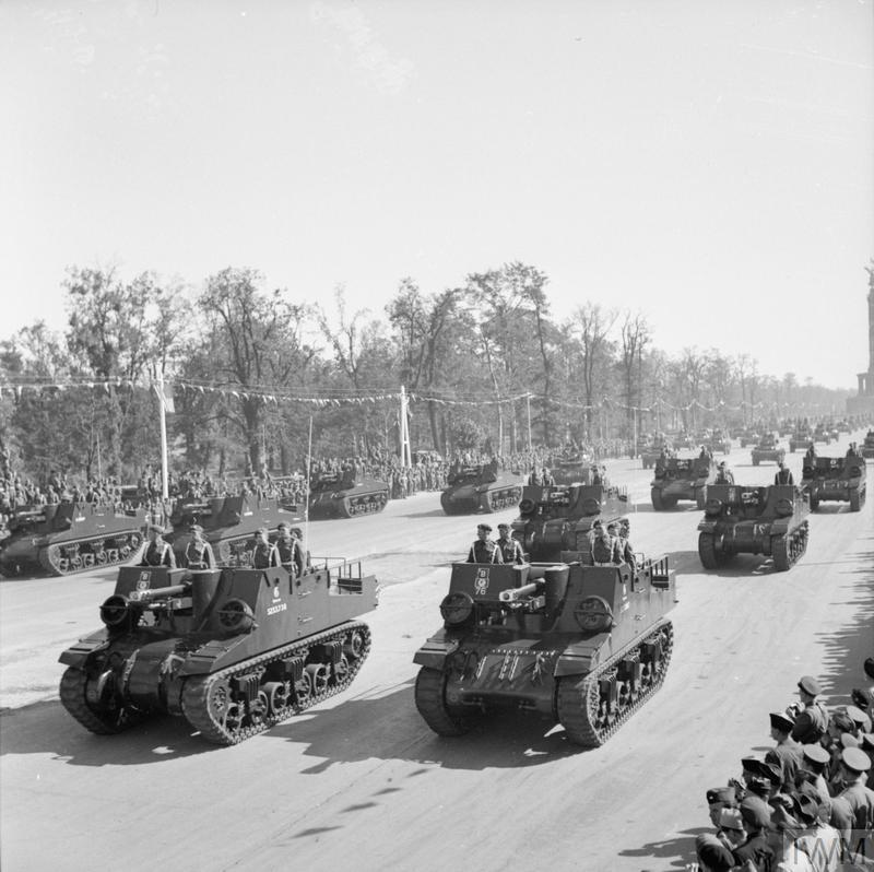 British Sexton self-propelled guns driving down the Charlottenburg Chaussee in Berlin during the Four Nations VJ Day parade.