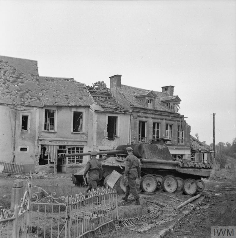 A knocked-out German Panther tank in the centre of Lingevres, 20 June 1944.