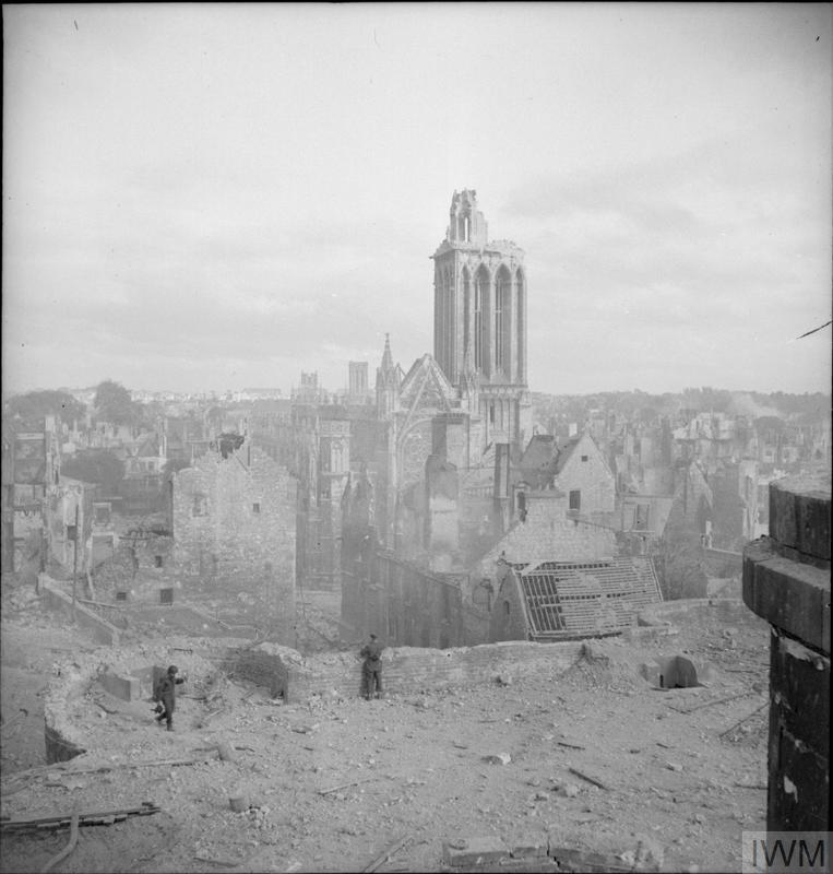 © IWM (B 6714) A general view of Caen showing the extensive damage caused by Allied bombing, 9 July 1944.