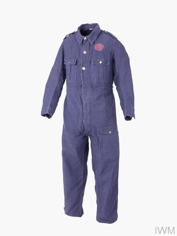 overalls blue heavy-duty cotton overalls, fly front fastening, three patch pockets, white metal buttons embossed with the letters ARP. On the left breast a blue oval cloth badge with a red silk surround within which are the letters ARP embroidered in red silk.