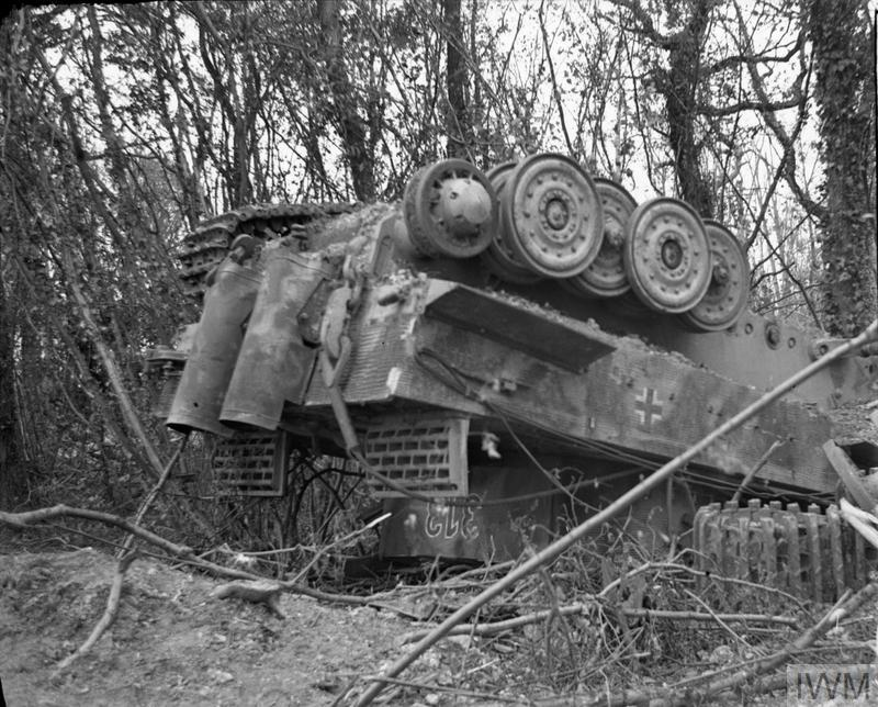 German Tiger I tank overturned at Manneville by Allied heavy bombing during Operation 'Goodwood', 18 July 1944.