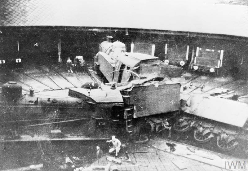 Wrecked locomotives in an engine shed at the Annemasse railway depot after being sabotaged by members of the French Resistance.