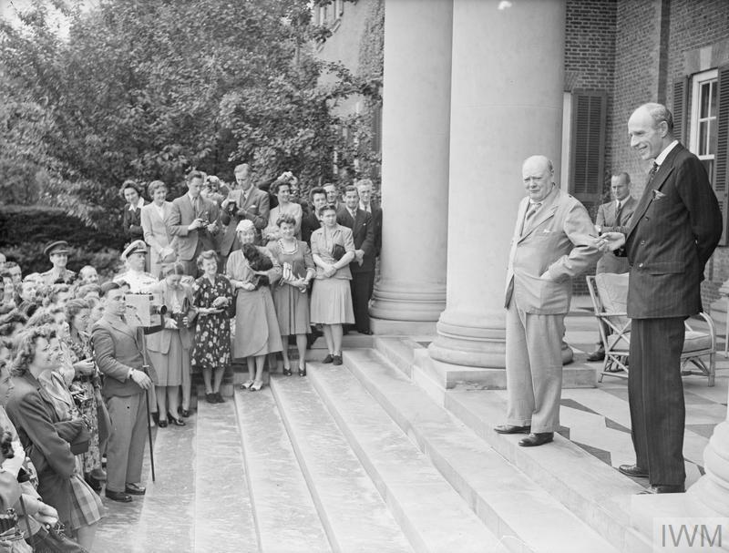 The Prime Minister and Lord Halifax with the staffs, on the steps of the Embassy.