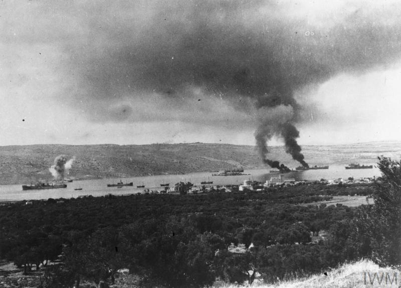 Two ships in Suda Bay, Crete, are burning after being hit be German bombers in June 1941.