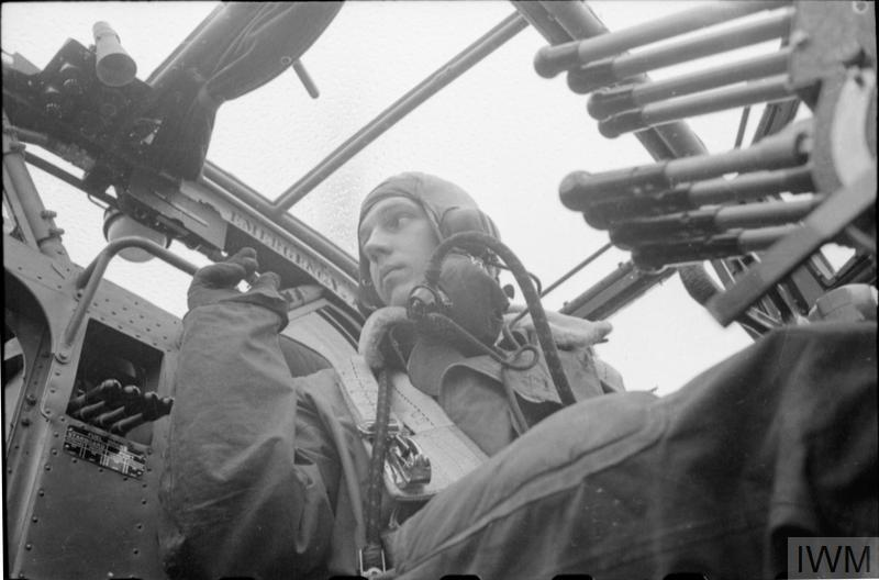 The pilot of a Handley-Page Halifax of No. 35 Squadron in his position prior to take-off at Linton-On-Ouse, Yorkshire.