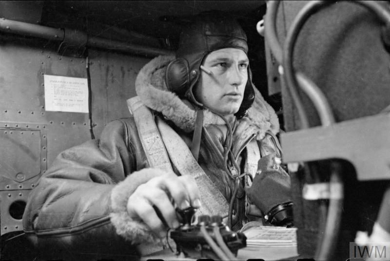 The wireless operator of a Handley-Page Halifax of No. 35 Squadron RAF, in his position prior to take-off at Linton-On-Ouse, Yorkshire.