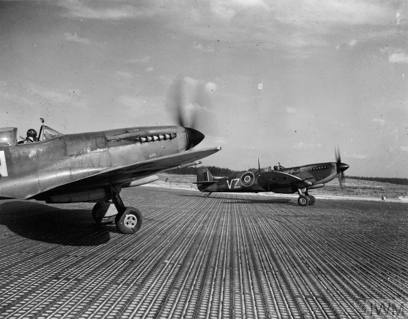 Supermarine Spitfire Mark IXEs of No. 412 Squadron RCAF, prepare to take off from the pierced steel planking (PSP) runway at B108/Rheine, Germany.