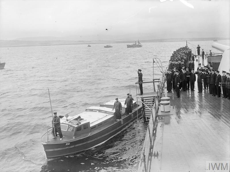 THE KING WITH THE HOME FLEET. 16 AUGUST 1943, SCAPA FLOW. THE KING VISITED MEN AND SHIPS OF THE HOME FLEET, HE WENT ABOARD THE FLOTILLA LEADER HMS ONSLOW WHICH TOOK HIM TO THE FLAGSHIP HMS DUKE OF YORK, WHERE HE WAS MET BY ADMIRAL SIR BRUCE FRASER, KBE, CB, C-IN-C HOME FLEET.