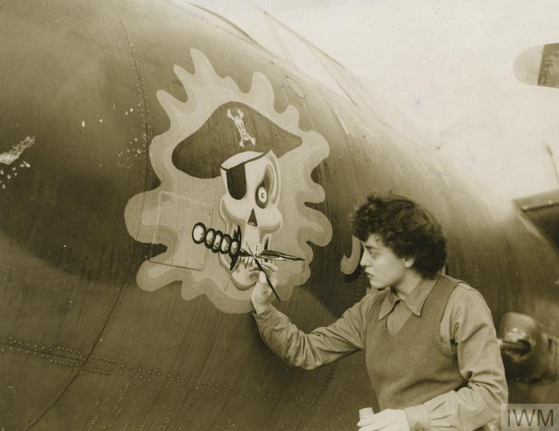 Private First Class Barbara O'Brien paints the nose art on a B-26 Marauder, the 'Jolly Roger', in 1943.