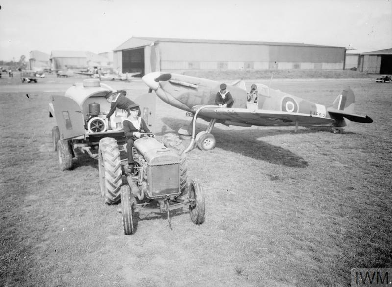 GROUND CREW SERVICE NAVAL AIRCRAFT. 2 SEPTEMBER 1943, ROYAL NAVAL AIR STATION FIGHTER DIRECTION STATION, YEOVILTON. WREN AIR MECHANICS AND OTHER ROYAL NAVAL PERSONNEL SERVICE AND MAINTAIN AIRCRAFT.