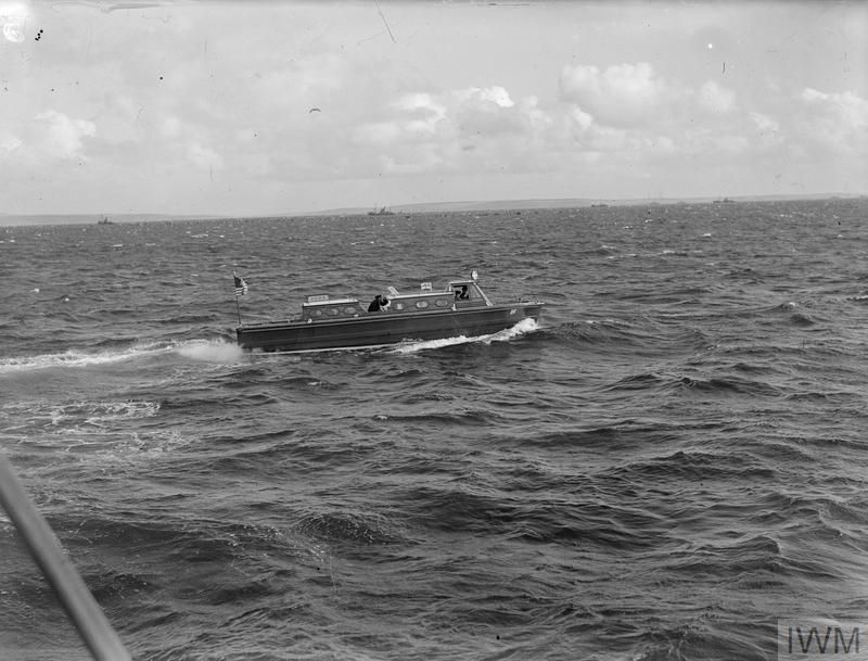 COLONEL KNOX'S VISIT, SEPTEMBER 1943, SCAPA FLOW. COLONEL FRANK KNOX, SECRETARY OF THE US NAVY, AND ADMIRAL H R STARK, COMMANDER OF US NAVAL FORCES IN THE EUROPEAN THEATRE, VISITED US SHIPS SERVING WITH THE HOME FLEET.