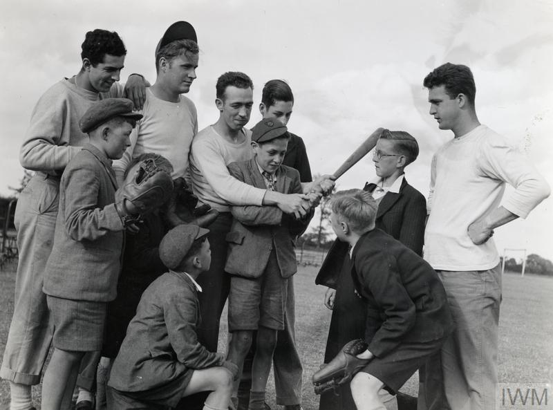 English boys visting an 8th Air Force base are given an introduction to baseball by USAAF personnel.