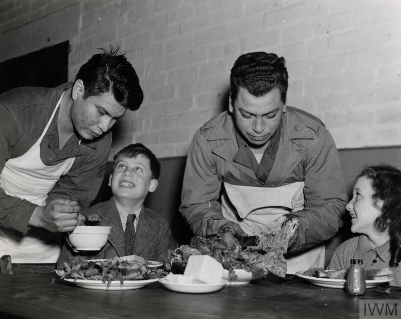 Corporal Joseph Sleeping Bear serves Thanksgiving dinner, Snetterton Heath, Norfolk, November 1944.