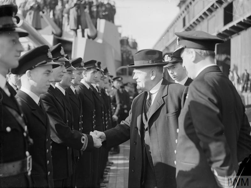 THE CRUISER GAMBIA FOR NEW ZEALAND. 3 OCTOBER 1943, LIVERPOOL. MR JORDAN, THE NEW ZEALAND HIGH COMMISSIONER, ATTENDED THE FORMAL HANDING OVER TO NEW ZEALAND OF THE CRUISER HMS GAMBIA.