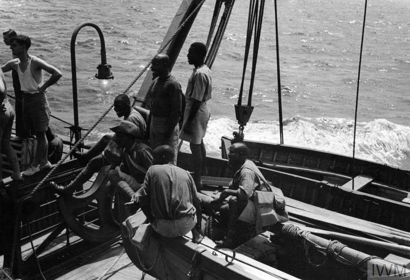 ON BOARD TROOP TRANSPORTS AT SEA. AUGUST 1941, ON AN AFRICAN TROOP CONVOY.