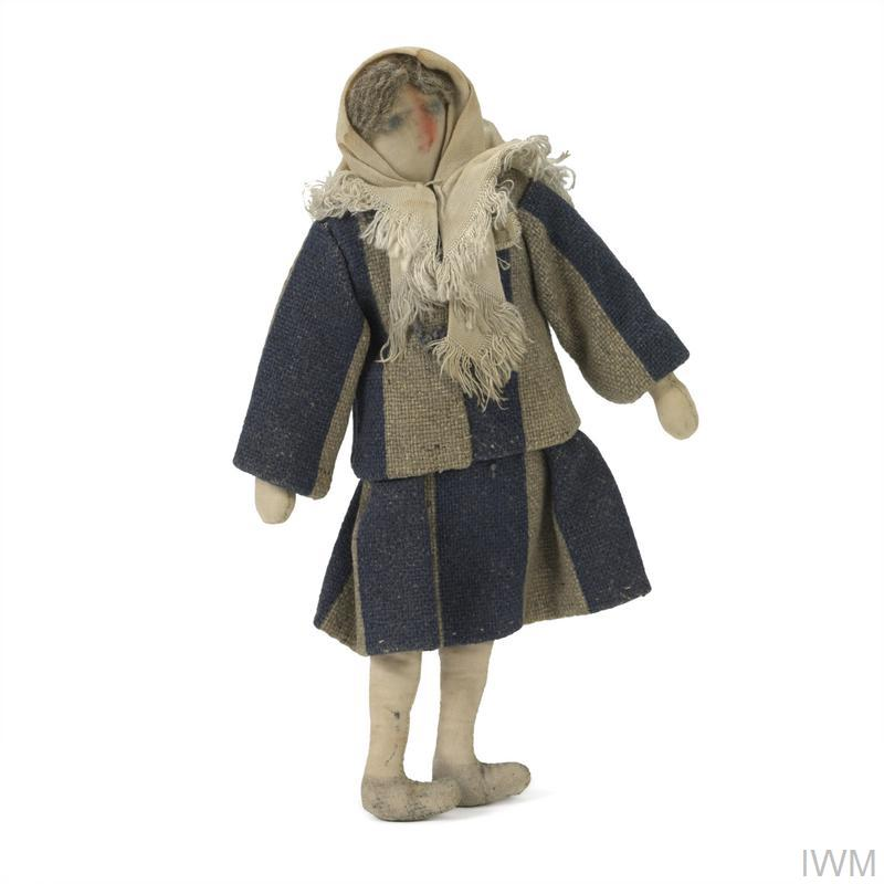 Rag doll of female concentration camp prisoner. Clothing is made from real prisoner's clothing.