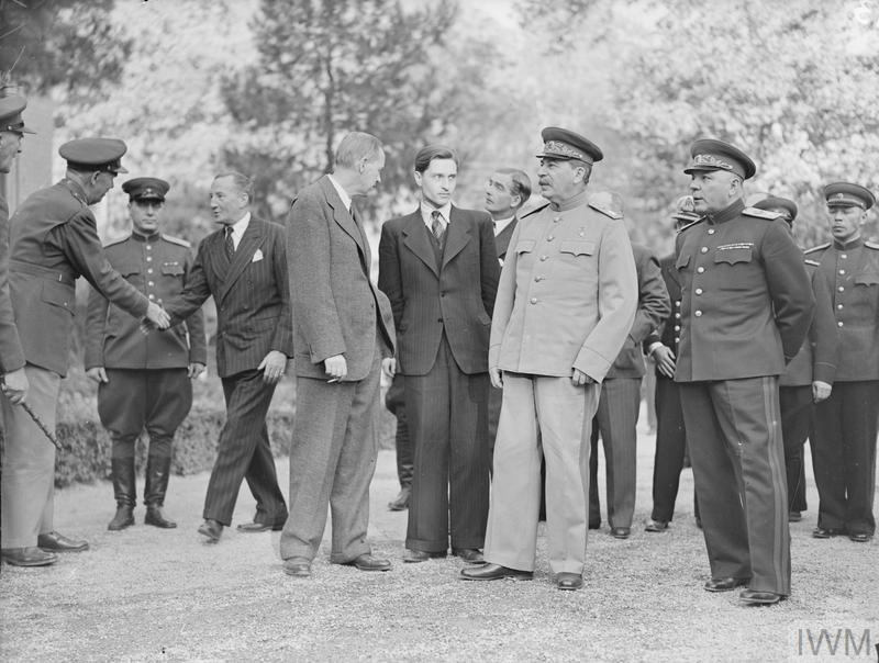 (© IWM A20716) Marshal Stalin in the grounds of the Soviet Legation with (on his left) Marshal Voroshilov, second right from M Stalin is Mr Harry Hopkins