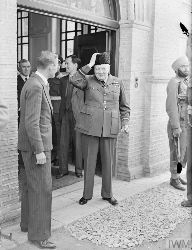 (© IWM A20723) Mr Churchill wearing his Persian lamb hat. Mr Churchill was presented the hat on his 69th birthday