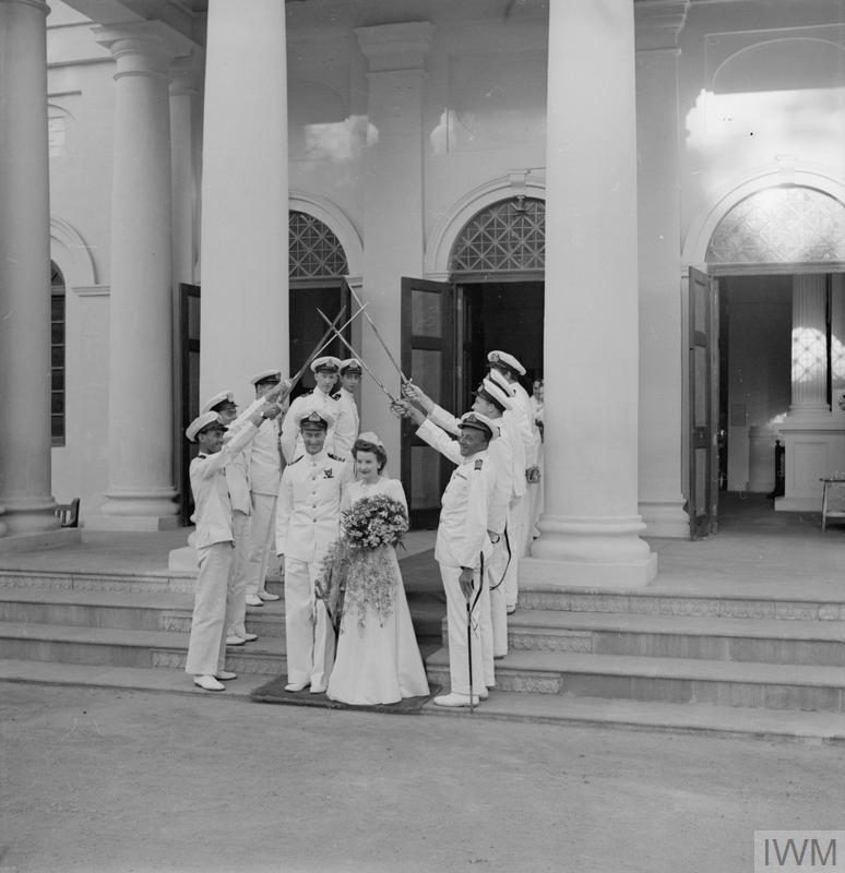 ALL NAVAL WEDDING IN OLD DELHI. 17 NOVEMBER 1943, ST JAMES CHURCH, OLD DELHI. LIEUTENANT COMMANDER MICHEAL HAWORTH, DSC, RN WAS MARRIED TO 3RD OFFICER CYNTHIA NOBLE, WRNS. BOTH ARE SERVING ON THE STAFF OF ADMIRAL SIR JAMES SOMERVILLE, COMMANDER IN CHIEF, EASTEN FLEET. THE BRIDE WAS GIVEN AWAY BY REAR ADMIRAL G J A MILES, CB.