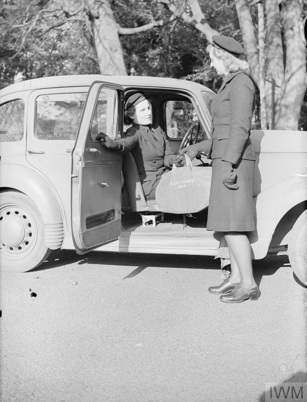 NEW JOBS FOR WRNS MOTOR TRANSPORT DRIVERS. 31 OCTOBER 1943, ROSYTH, SCOTLAND. WREN MOTOR TRANSPORT DRIVERS ARE TAKING OVER THE RUNNING OF SOME OF THE VEHICLES FORMERLY HANDLED BY MEN. THEY DRIVE DUTY CARS AND SMALL CIRCULATION VANS AND BRAKES.