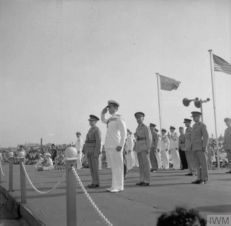 Lord Louis Mountbatten, Supreme Allied Commander, South East Asia, takes the salute during the VJ Day Parade on the Galle Face Green, Columbo, Ceylon.