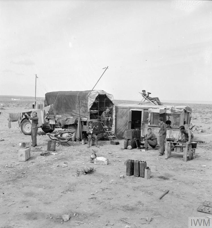 A Wireless Observer Unit post at work in the Western Desert. After Operation CRUSADER, about thirty of these fully mobile posts were deployed in a ring covering the approaches to El Adem, Libya, in order to provide visual early warning of enemy aircraft movements for No. 211 Group's Operations Room, with whom they were in contact by wireless telegraphy. IWM Commons photo copyright