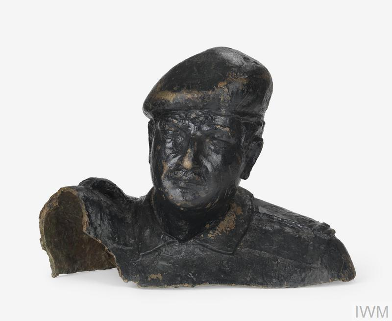Broken bronze bust of Saddam Hussein, recovered from in Iraq in 2004