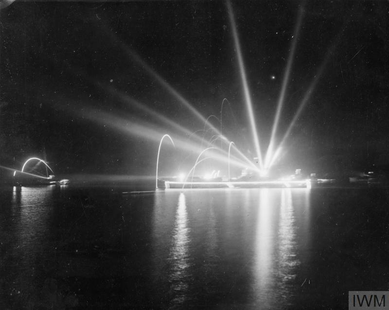 From the EMPRESS as units of the British East Indies Fleet celebrated VJ night at Trincomalee.