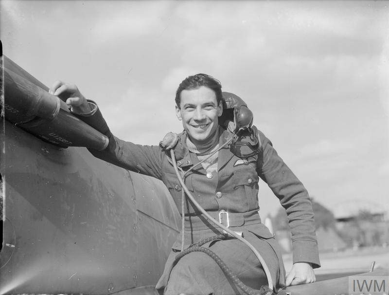 Pilot Officer Wallace 'Jock' Cunningham of No. 19 Squadron sits on the wing of his Spitfire at Fowlmere, September 1940.
