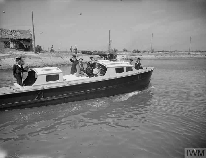 PRIME MINISTER VISITS NORMANDY FRONT. 12 JUNE 1944, MR CHURCHILL TRAVELLED TO FRANCE IN HMS KELVIN, COMMANDED BY LIEUT CDR R M W MACFARLAN, RN. HE WAS ACCOMPANIED BY GENERAL SIR ALAN BROOKE, CHIEF OF THE IMPERIAL GENERAL STAFF, AND FIELD MARSHAL SMUTS, AND WAS MET BY GENERAL MONTGOMERY.