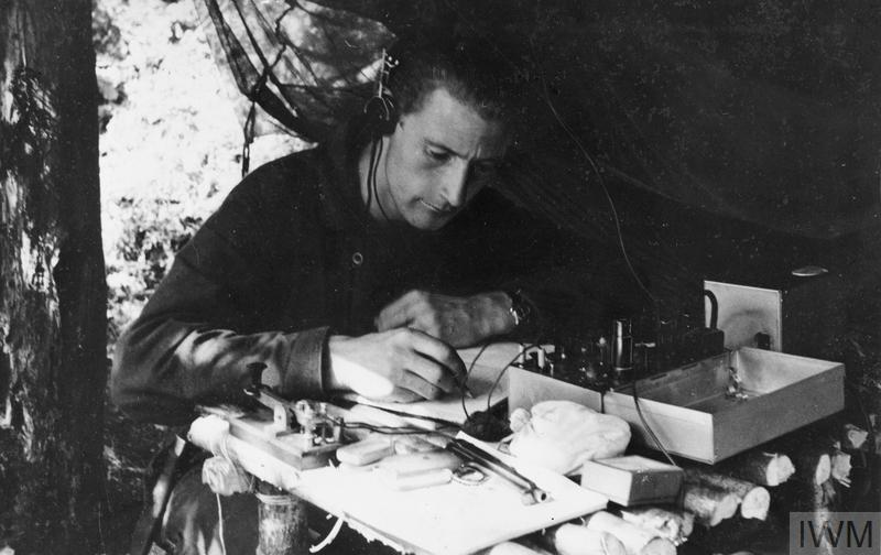© HU 68501 Oluf Olsen, an SIS wireless operator, sits at his radio set deciphering an incoming message