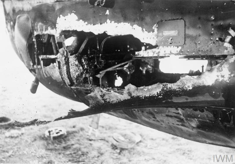 The shell-torn rear gunner's compartment of Handley Page Hampden Mark I, P1355 'OL-W', of No. 83 Squadron RAF photographed at Scampton' Lincolnshire, on the morning after returning from a night attack on invasion barges at Antwerp, Holland.