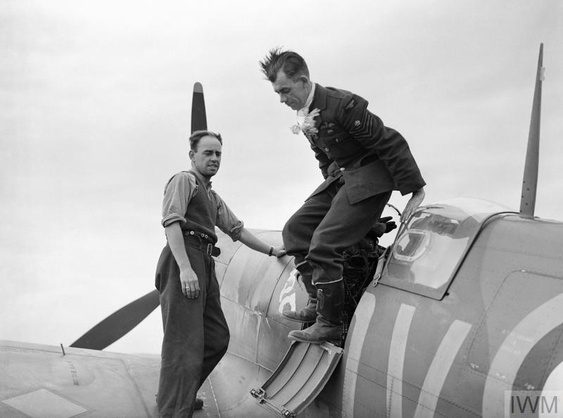 "Flight-Sergeant George ""Grumpy"" Unwin of No. 19 Squadron RAF climbs out of his Supermarine Spitfire Mark I at Fowlmere, Cambridgeshire, after a sortie. Unwin shot down 14.5 enemy aircraft between May and September 1940."