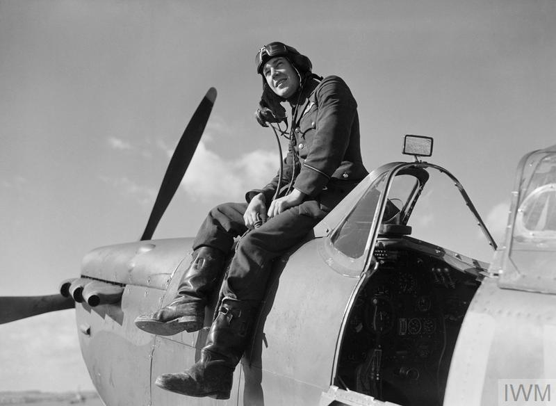 Flying Officer Leonard Haines of No. 19 Squadron sits on the forward fuselage of his Spitfire Mk Ia at Fowlmere, September 1940. Haines shot down six enemy aircraft during the Battle of Britain.
