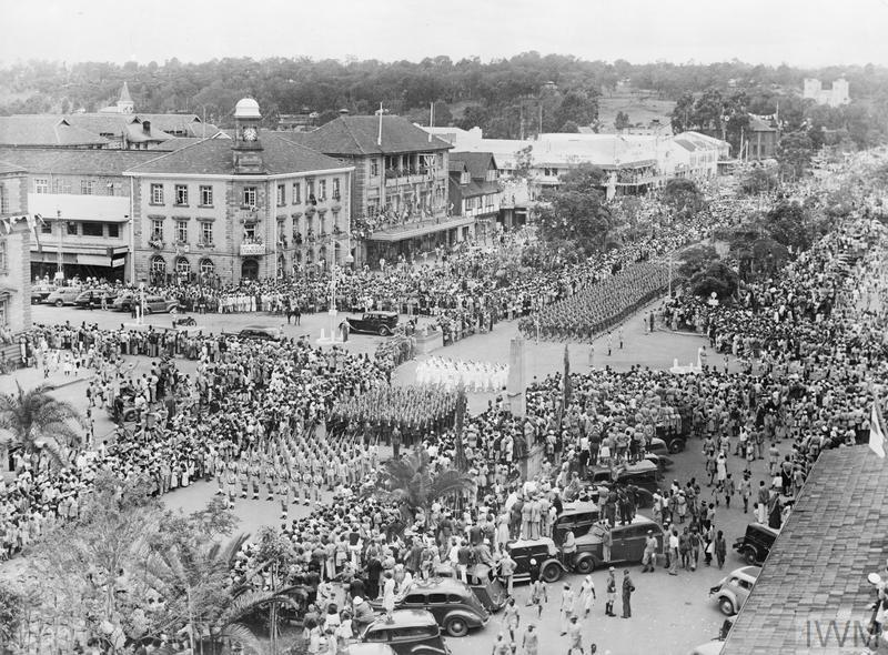 A parade of 5,000 troops was part of Nairobi's VJ Day Celebrations. Picture shows: The parade seen from the roof of a tall building in Delamere Avenue.