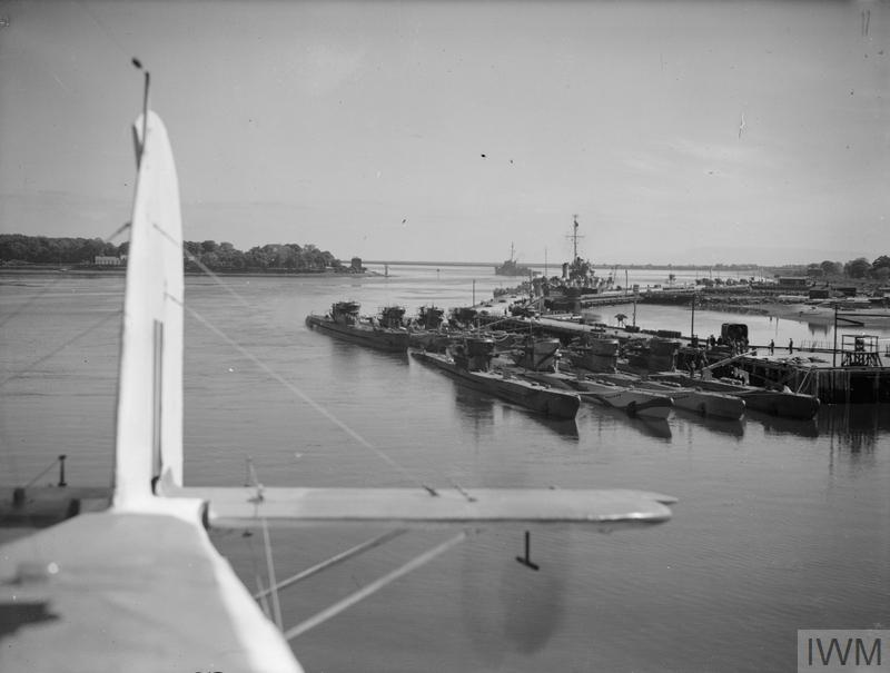 SURRENDERED U-BOATS GATHER IN NORTH IRELAND PORT. 24 AND 25 MAY 1945, LISAHALLY, NEAR LONDONDERRY. PART OF THE FLEET OF SURRENDERED U-BOATS MOORED AT LISAHALLY, UNDER ARMED GUARD. TWENTY SEVEN WERE THERE ON 24 MAY 1945.
