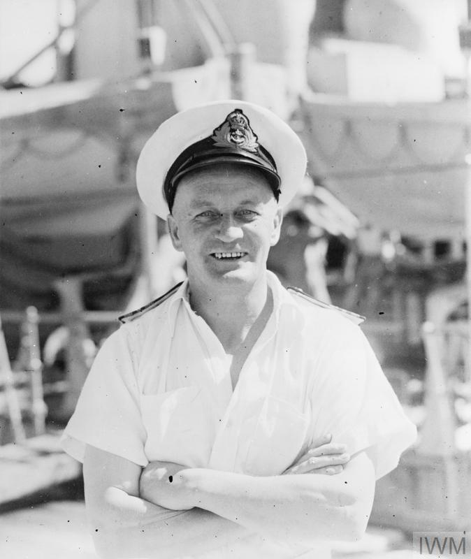 FROM VICAR TO NAVY ENGINEER. 29 JULY 1945, BRITISH EAST INDIES FLEET. LIEUTENANT COMMANDER (E) E C SEAGER, RN, SERVING IN A DEPOT SHIP OF THE BRITISH EAST INDIES FLEET, WAS ONCE ASSISTANT CURATE AT REDRUTH PARISH CHURCH, CORNWALL, AND LATER TOOK OVER THE DIOCESE OF FIVE CHURCHES IN THE SCILLY ISLES, WHERE HE SERVED FOR 18 MONTHS UNTIL THE BEGINNING OF THE WAR. HAVING SERVED IN THE ROYAL NAVY IN THE FIRST WORLD WAR, HE APPLIED TO REJOIN AS A FIGHTING MAN AND WAS ACCEPTED AND APPOINTED BASE ENGINEER IN EAST AFRICA, LATER VOLUNTEERING FOR SERVICE FURTHER EAST.
