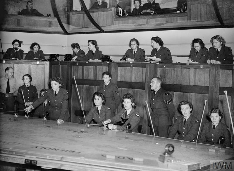 WAAF plotters at work in the Operations Room at Headquarters, No 11 Group, Uxbridge, Middlesex.