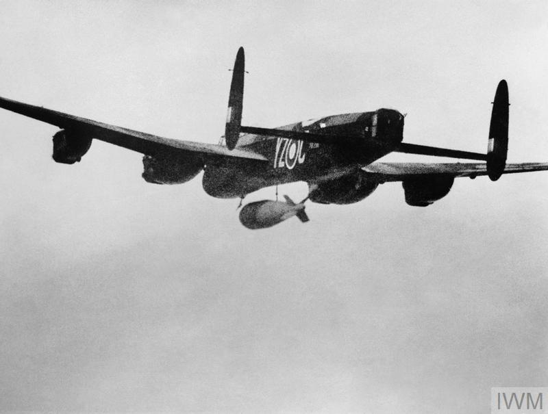 Avro Lancaster B Mark I (Special), PB996 'YZ-C', of No. 617 Squadron RAF, flown by Flying Officer P Martin and crew, releasing a 22,000-lb MC deep-penetration bomb (Bomber Command executive codeword 'Grand Slam') over the viaduct at Arnsberg, Germany.