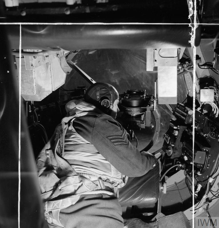 The bomb aimer in an Avro Lancaster, checking over the instruments in his position before take off from Scampton, Lincolnshire.