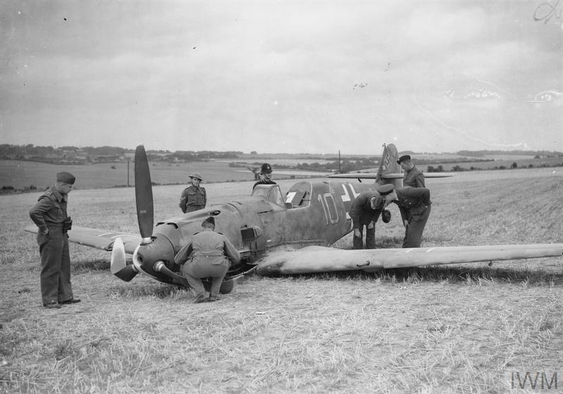 Airmen and soldiers inspect Messerschmitt Bf 109E-4 (W.Nr. 5587) flown by Ofw. Fritz Beeck of 6./JG 51, which force-landed at East Langdon in Kent while escorting an attack on Manston, 24 August 1940.